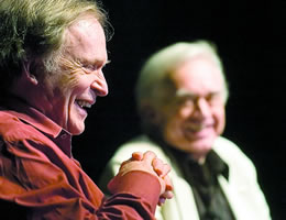 Dick Cavett, with Ron Hull of NET in the background, speaking at a Q&A session Saturday afternoon at Northeast Community College in Norfolk. (Kent Warneke, Norfolk Daily News)
