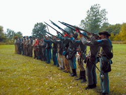 Reenactor soldiers drilling. (Annabel Lee Major)