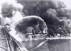 Firefighters battle a fire on Ohio's Cuyahoga River in 1952. The 1969 blaze, one of nine on the river since 1868, came at a time of increasing environmental awareness and symbolized years of environmental neglect.  (United Press International)