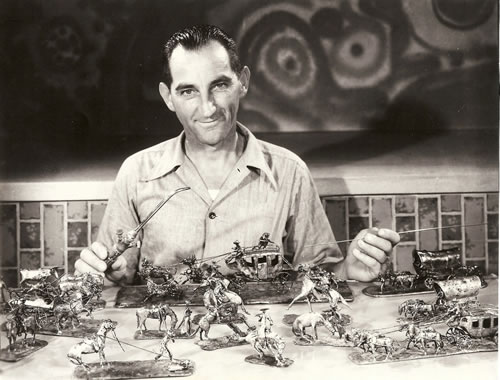 Floyd F. Nichols, 1930s, working on small metal figurines (Bone Creek Museum of Agrarian Art)