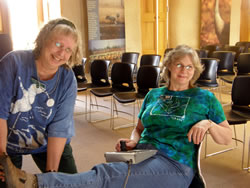 While operating the crane cam, Rowe's remote-controlled riverside video camera, Deb Hann takes a break to pose for the camera and give a hard time to her friend and fellow volunteer Beverly Hof-Miller. (Erv Nichols)
