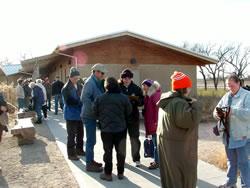 As visitors arrive for the evening crane viewing at Rowe Sanctuary, volunteer Sherylanne Waterman of Funk Nebraska checks them in. (Alan J. Bartels)