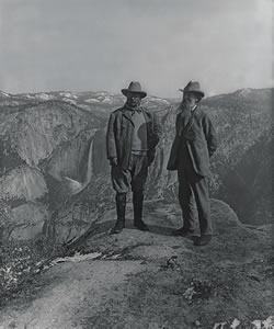 U.S. President Theodore Roosevelt (left) and nature preservationist John Muir, founder of the Sierra Club, on Glacier Point in Yosemite National Park, 1906. In the background is the Upper and lower Yosemite Falls. (Library of Congress)