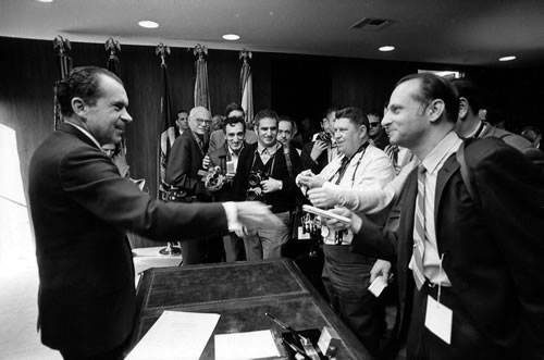 Bill signing of the National Environmental Policy Act of 1969 with President Nixon giving pens to members of the press corps, Jan. 1, 1970. (Oliver Atkins/White House Photo Office)