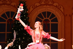Clara (Rachel Dowd) is enchanted with her nutcracker in this 2010 performance. (Lincoln Midwest Ballet Company)