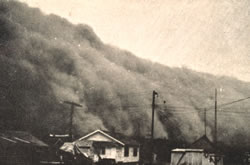 "A wall of dust approaching a Kansas town, from ""Effect of Dust Storms on Health,"" U.S. Public Health Service, Reprint No. 1707 from the Public Health Reports, Vol. 50, No. 40, Oct. 4, 1935. (NOAA National Weather Service Collection)"