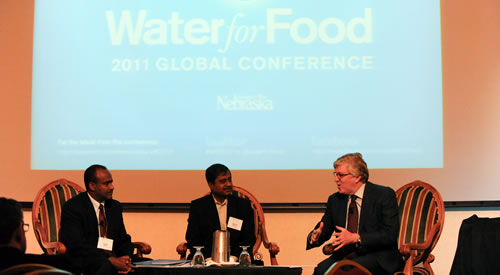 From left, Kebede Ayele, country director for International Development Enterprises in Ethiopia, and Soumen Biswas, executive director of Professional Assistance for Development Action in India, talk with Jeff Raikes, CEO of the Bill & Melinda Gates Foundation, during the keynote dialogue of the 2011 global Water for Food Conference in Lincoln, Neb. (DWFI)