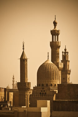 The sky of Cairo, Egypt, featuring various mosque minarets. (ugurhan/iStockPhoto)