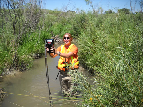 Trained technicians and hydrologists periodically make physical measurements of streamflow, called discharge, to relate it to a given water level, also known as stage. (Robert Swanson)