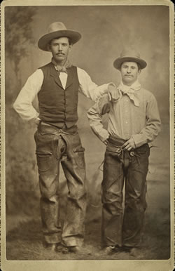 "Louis J. F. ""Billy the Bear"" Iaeger (right) in his cowboy outfit, about 1880. He was caught in a blizzard near Rock Creek, Wyoming Territory, in January 1883 and his frozen lower legs and fingers were amputated. In 1885 he settled in Chadron, Neb., and served as justice of the peace, city clerk and clerk of the county court before his death in 1930. (Dawes County Historical Society, Chadron, Neb.)"