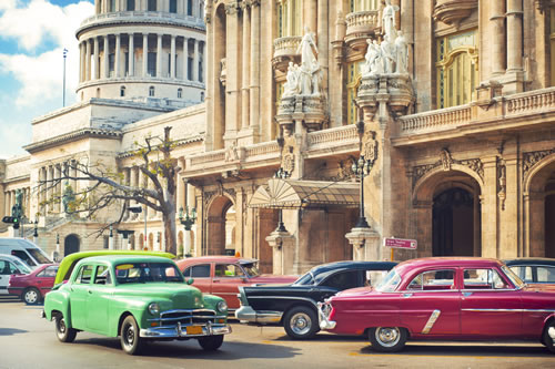 Cars parked near Gran Theatre and El Capitolio in the center of Havana, Cuba. (ArtMarie/iStock)