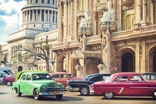 Cars parked near Gran Theatre and El Capitolio in the center of Havana, Cuba. (ArtMarie/iStock)