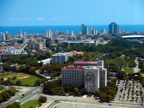 The Havana skyline and waterfront, with Che's image in iron on the Interior Ministry building in the Plaza de la Revolución. (Courtesy  Arthury Pearstein)